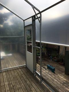 small-backyard-greenhouse-construction.jpeg